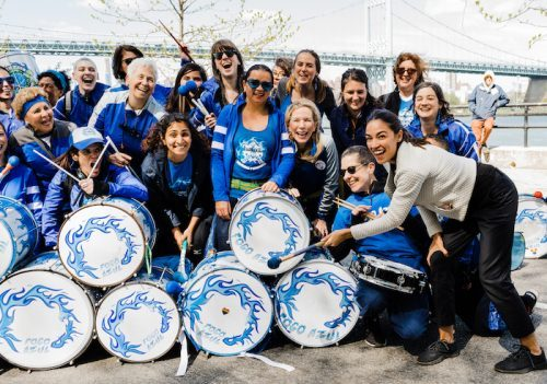 Female Drummers posing at a fundraiser event for AOC
