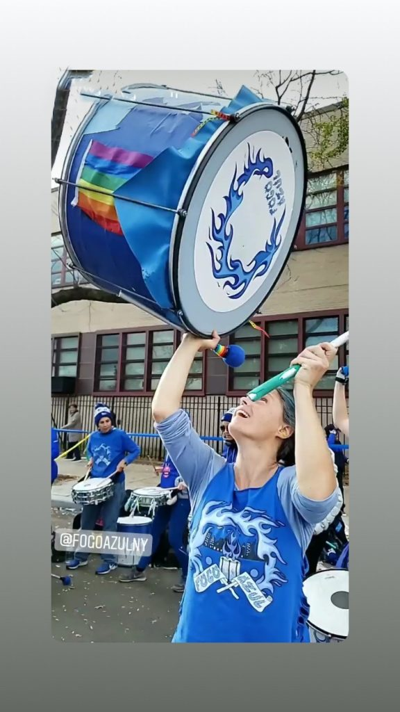 surdo drum being lifted by female drummer in NYC